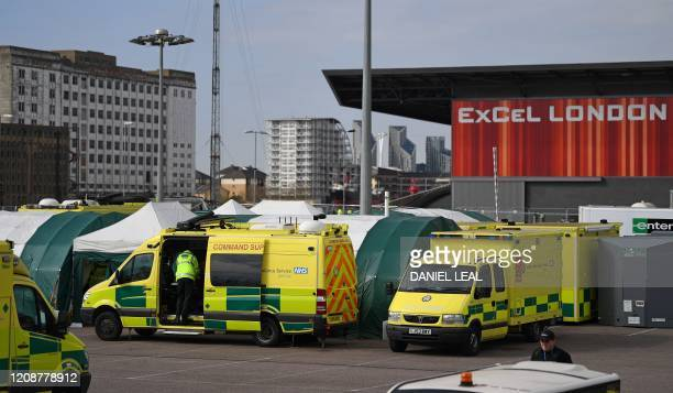 London Ambulance vehicles are seen outside the ExCeL London exhibition centre in London on April 1 which has been transformed into the NHS...