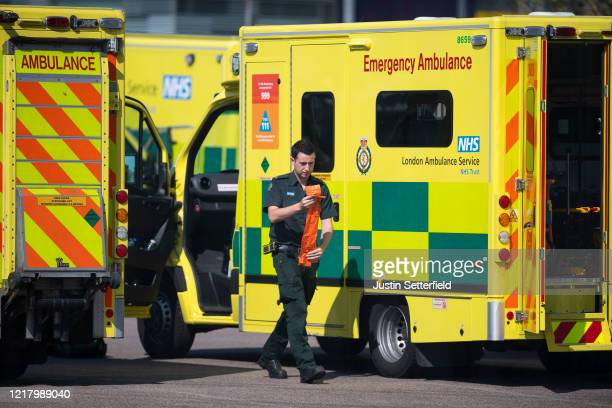 London ambulance worker prepares equipment outside the NHS nightingale hospital at the Excel on April 10 2020 in London England Public Easter events...