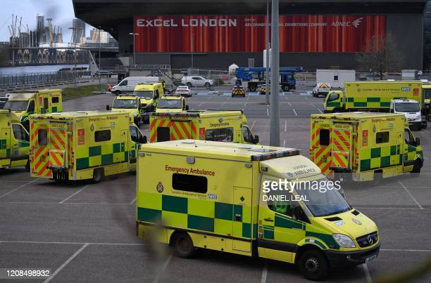 London Ambulances are pictured parked in the car park at the ExCeL London exhibition centre in London on March 29 which has been transformed into a...
