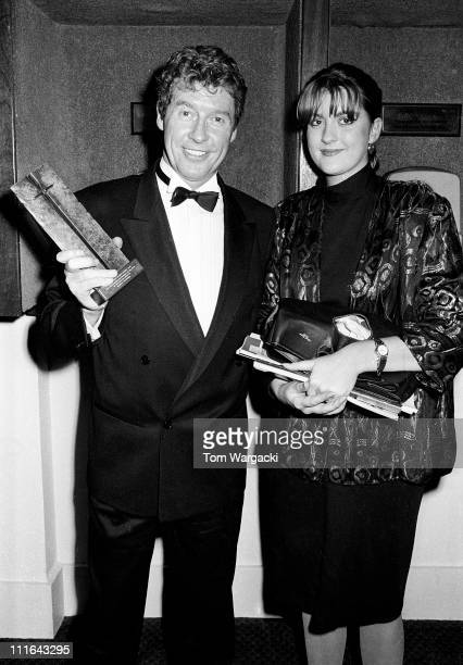 London April 1987. Michael Crawford with daughter Emma winning an award for best actor in a musical at the Laurence Olivier Awards, Royalty Theatre...
