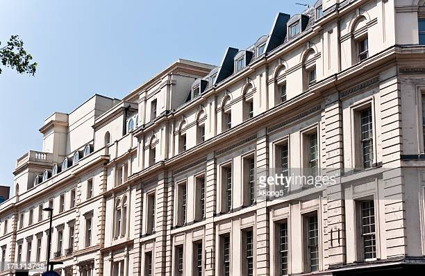 london architecture:  classic fassade in sunny afternoon - oxford street london stock photos and pictures