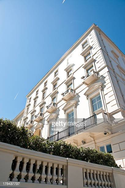 london architecture: classic white buildings in warm sunny summer day
