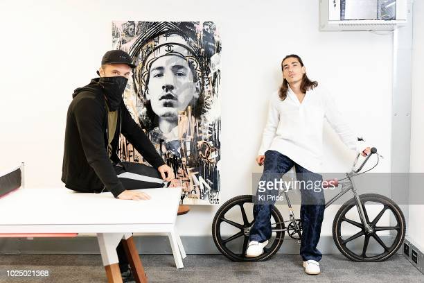 London artist Endless presents Arsenal player Hector Bellerin with a painting of himself on August 28 2018 in London England