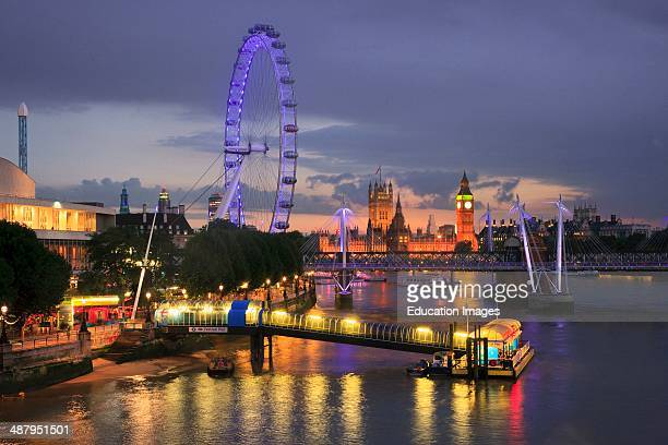 London At Dusk With The London Eye Jubilee Bridge And Houses Of Parliament In View As Seen From Waterloo Bridge England