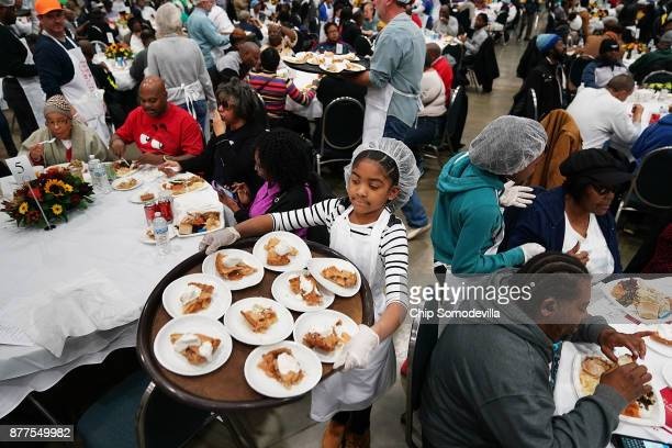 London Baker helps serve Thanksgiving dinner for more than 5,000 District of Columbia resident during The Salvation Army and Safeway's 18th annual...