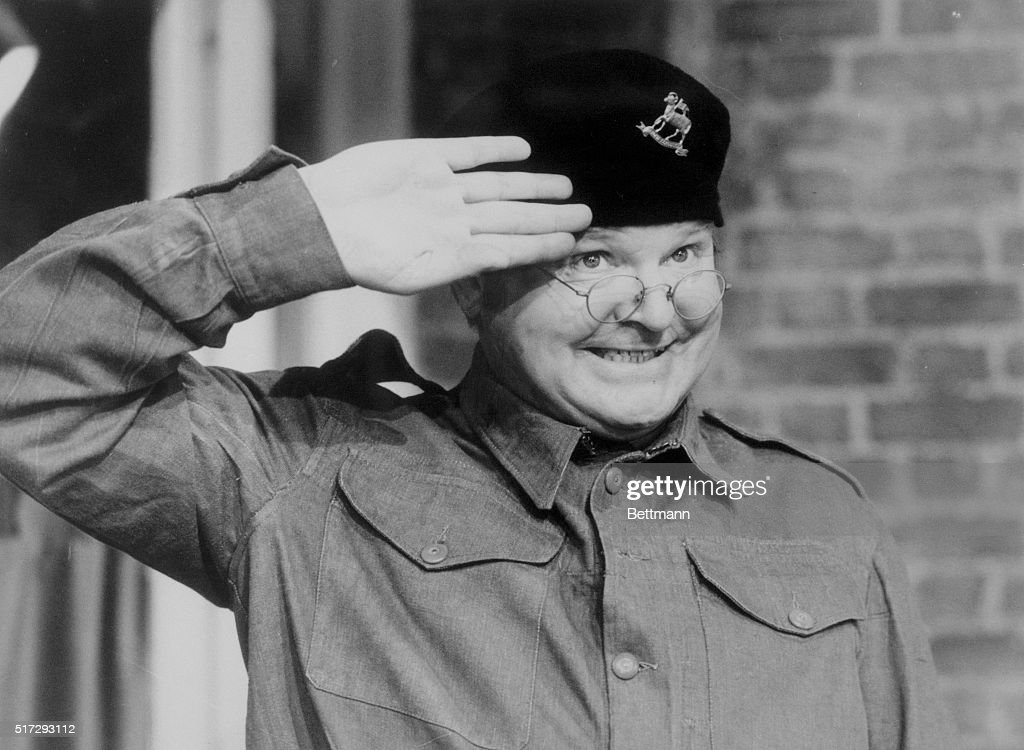 Comedian Benny Hill Saluting in His Television Show : News Photo