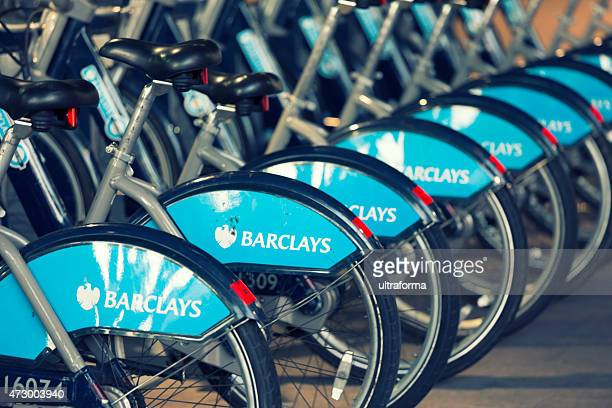 london bicycle hire point - barclays brand name stock photos and pictures