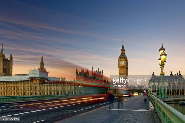 uk, london, big ben, houses of parliament and bus on westminster bridge at dusk - double decker bus stock pictures, royalty-free photos & images