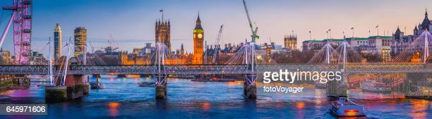 London Big Ben Westminster landmarks illuminated at sunset Thames panorama