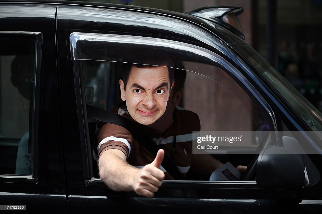 A London black cab driver wears a Mr Bean mask as he takes part in a protest against Transport for London (TfL) on May 26, 2015 in London, England. The demonstration, organised by United Cabbies Group, is claiming that cab drivers are let down by TfL refusals to enforce safety regulations on London mini-cab drivers with claims, among others, that mini-cabs are carrying people without adequate insurance and that the authorities are turning a bind eye to touting outside nightclubs.