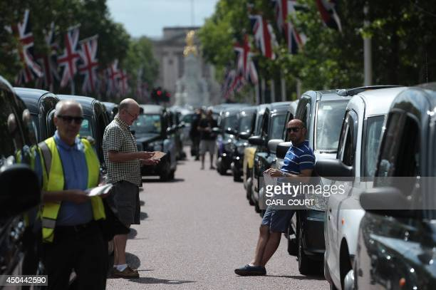 London Black Cab drivers take part in a protest against a new private taxi service 'Uber' a mobile phone app on the Mall leading to Buckingham Palace...