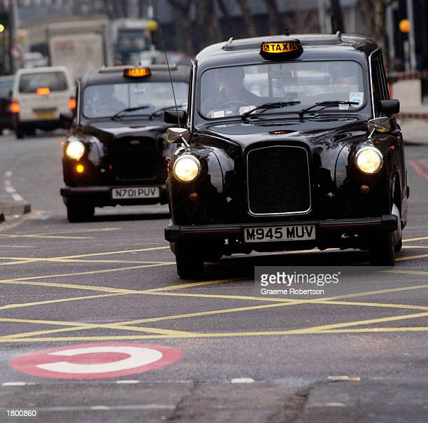 A london black cab passes one of the congestion charge logos February 17 2003 in London Hundreds of cameras which read vehicle number plates...