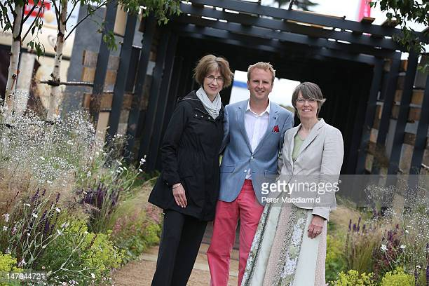 London bombing survivor Matthew Childs stands in his own garden design entitled 'Light at the End of the Tunnel' with fellow survivors Liz Owen and...
