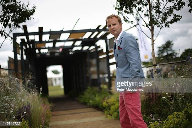 London bombing survivor Matthew Childs stands in his own garden design entitled 'Light at the End of the Tunnel' at The Hampton Court Palace Flower...