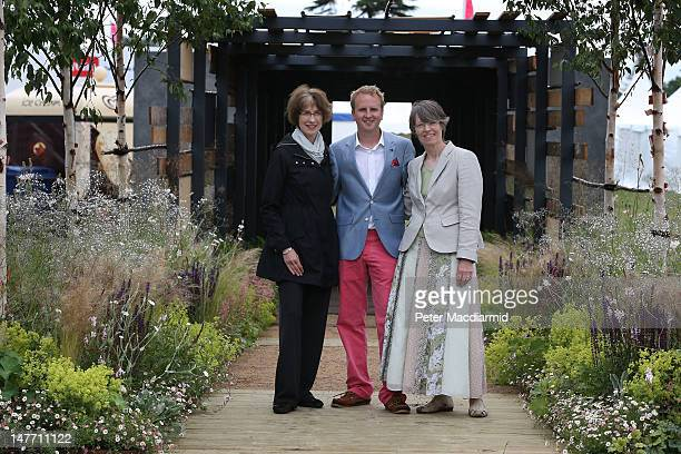 London bombing survivor Matthew Childs stands in his own garden design, entitled 'Light at the End of the Tunnel', will fellow survivors Liz Owen and...