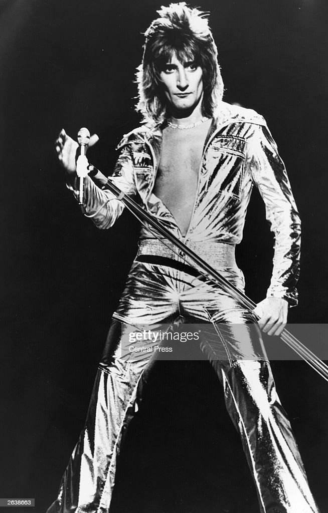 London born rock star, singer Rod Stewart, in a spectacular silver jumpsuit during the recording of his own television spectacular 'A Night On The Town'.