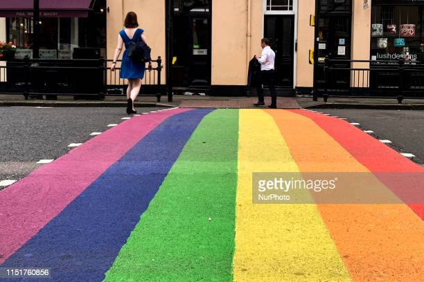 London borough of Greenwich show their support to Pride in London by painting a zebra crossing in the rainbow flag colours, in London, United...
