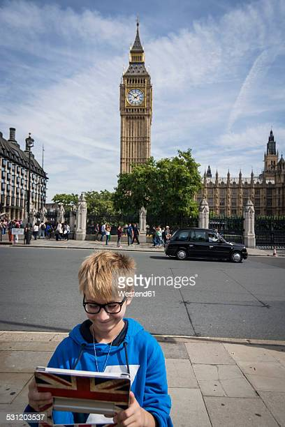 UK, London, boy taking a selfie in front of Big Ben with his digital tablet