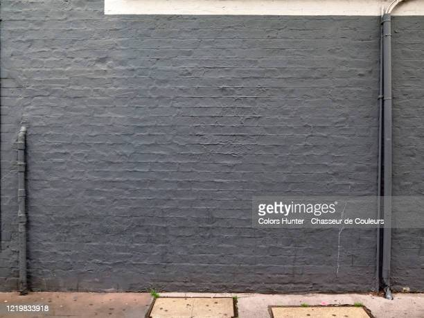 london brick house facade with water pipe and electrical installation - surrounding wall stock pictures, royalty-free photos & images