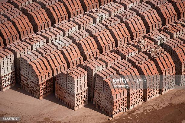 London Bricks sit in stack at the Forterra Building Products Ltd brickworks near Peterborough UK on Thursday March 31 2016 Forterra a UK producer of...