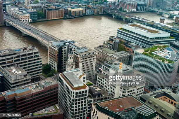 london bridge and the monument, a symbol of great fire - great fire of london stock pictures, royalty-free photos & images