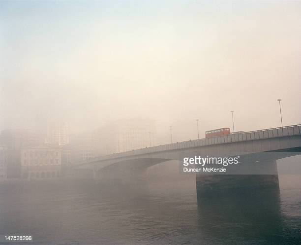 london bridge in morning mist or fog - london bridge stock photos and pictures