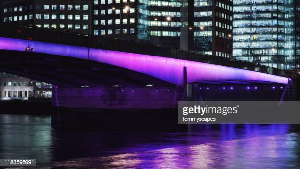 london bridge lit up at night - purple stock pictures, royalty-free photos & images