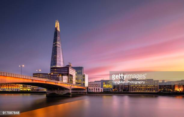 london bridge, river thames, united kingdom - londra foto e immagini stock