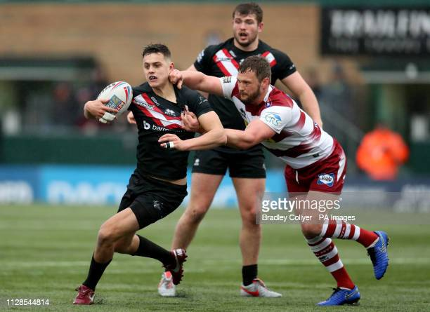 London Broncos's Alex Walker is tackled by Wigan Warriors' Sean O'Loughlin during the Betfred Super League match at Trailfinders Sports Club London