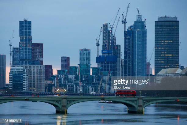 London bus crosses Westminster Bridge over the River Thames in view of construction work in the Nine Elms and Vauxhall districts in London, U.K., on...