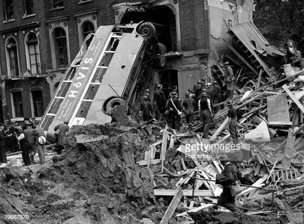 London bus lies wrecked after being hit by a bomb during a German air raid on London other buildings were severely damaged