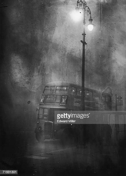 A London bus makes its way along Fleet Street in heavy smog 6th December 1952
