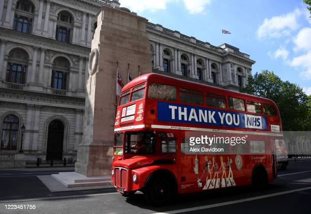 London bus reading 'Thank You NHS' drives past the decorated Cenotaph on May 07 2020 in London England United Kingdom The UK will commemorate the...