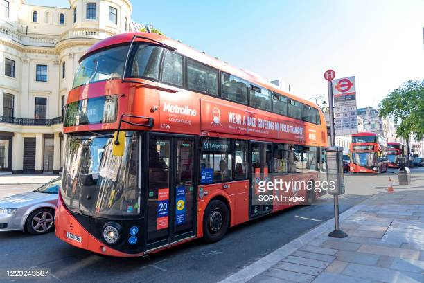 London Bus with a notice on the side reading Wear a face covering on public transport Secretary of State for Transport Grant Shapps announced that...