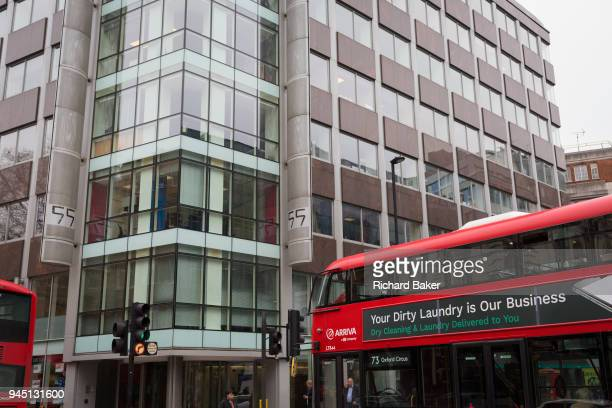 London bus with an ad for dirty washing drives past the offices of Cambridge Analytica on New Oxford Street, the UK tech company accused of...