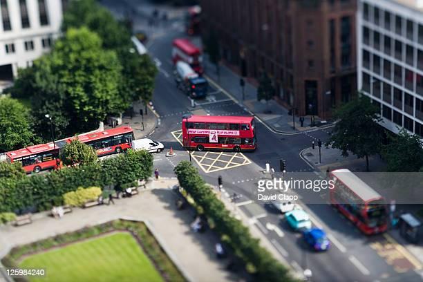 London buses at junction, London, UK