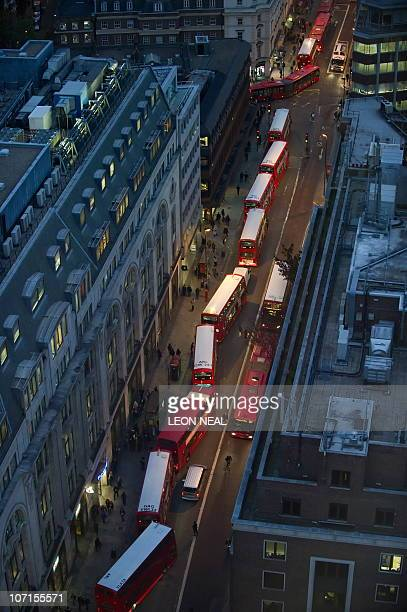 London buses queue along New Oxford Street in central London on November 3 2010 A fresh strike by thousands of staff on London's Underground rail...
