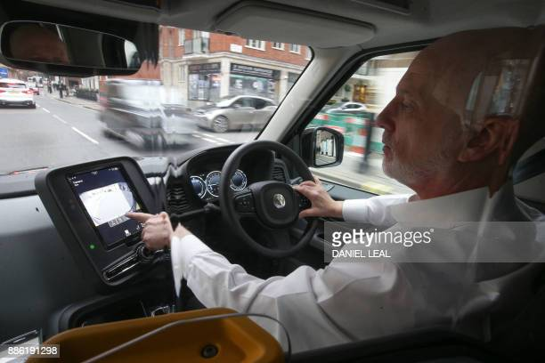 London cab driver Peter Powell who has been driving for close to 22 years uses the digital screen as he drives the new electric TX eCity taxi in...