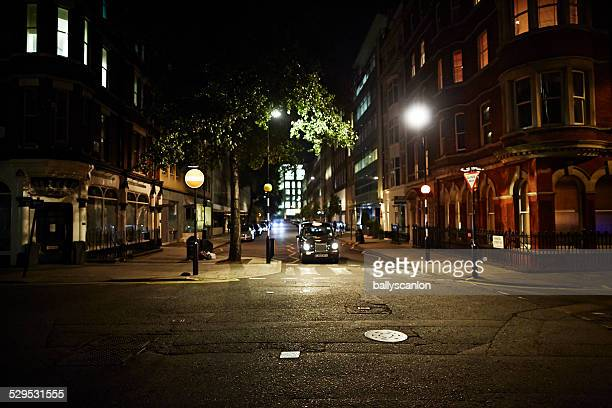 london cab on street at night - street light stock pictures, royalty-free photos & images