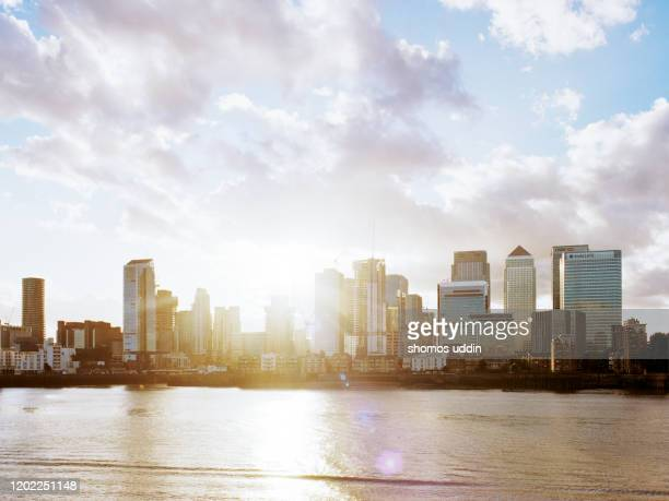 london canary wharf skyline at sunset - isle of dogs london stock pictures, royalty-free photos & images