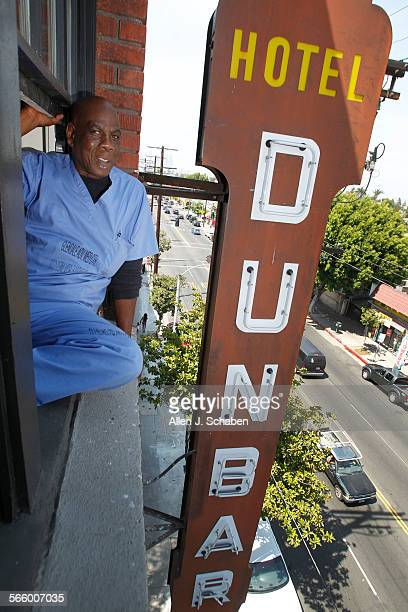 London Carter a disabled veteran, sits in his 5th-floor apartment window overlooking the historic Dunbar Hotel sign at the Dunbar Hotel, on S....