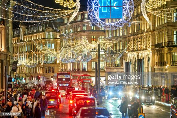 london christmas lights on regents street - central london stock pictures, royalty-free photos & images