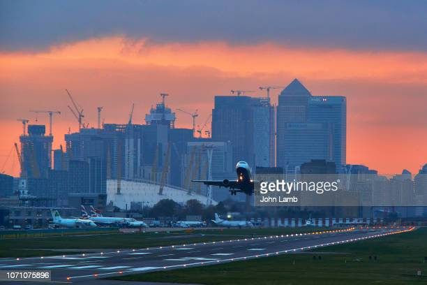 london city airport at dusk. - transportation stock pictures, royalty-free photos & images