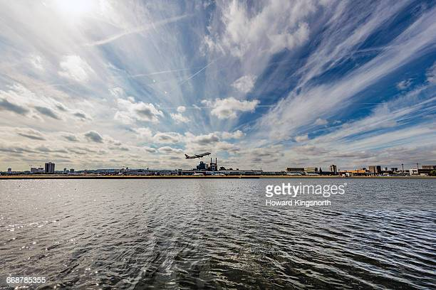 london city airport with plane taking off - london city airport stock pictures, royalty-free photos & images