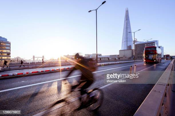 london city at sunrise during rush hour - dawn stock pictures, royalty-free photos & images