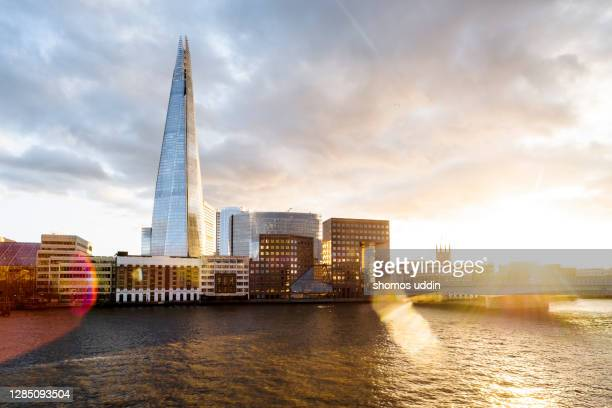 london city at sunset with dramatic sky overhead - sunset stock pictures, royalty-free photos & images