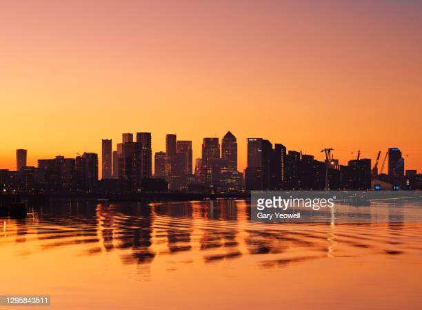 london city canary wharf skyline at sunset - sunset stock pictures, royalty-free photos & images