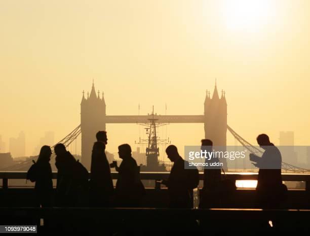 london city commuters and the skyline at sunrise - culture britannique photos et images de collection