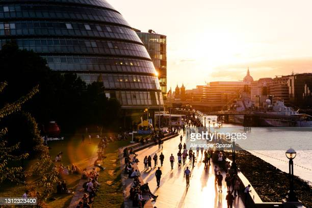 london city hall and crowds of people at sunset in london, england, uk - crowded stock pictures, royalty-free photos & images