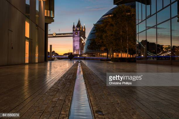 london city hall and the tower of london reflect in the water - guildhall london stock pictures, royalty-free photos & images